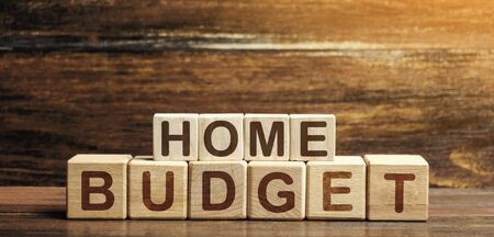 Home budget made of blocks. Planning financial income and expenses, saving and reducing expenses. Self-control, monitoring. Economic literacy and foresight, accumulation of savings. Payment of taxes. Stock fotó