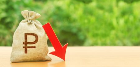 Russian ruble money bag and red arrow down. Depreciation of national currency, inflation, investment attractiveness. Economic decline fall difficulties. Deposit interest rate reduction, cheap loans.