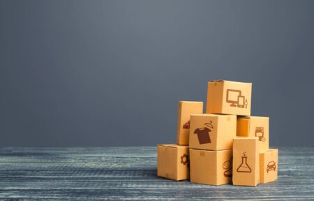 Stock pile of cardboard boxes. Production goods and products, distribution and trade exchange goods, retail sales. Global business, import, export. Freight transportation. Logistics and warehousing.