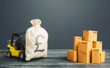 Forklift truck carries a pound sterling GBP money bag. Profit from trade and exchange of goods. Investments financing in production, taxes, income revenues and costs. High productivity superprofits