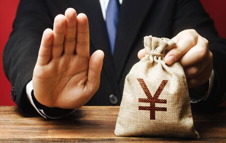 Businessman refuses to give yen yuan money bag. Refusal to grant loan mortgage, bad credit history. Financial difficulties. Refuses cooperate. Economic sanctions, confiscation funds