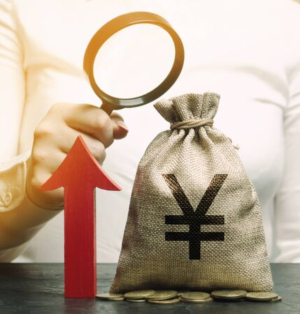 Bag of yuan  yen and red up arrow with business woman. Successful business. Increase profits and capital. Budget and economic growth. Strengthening of national currency, investment attractiveness.