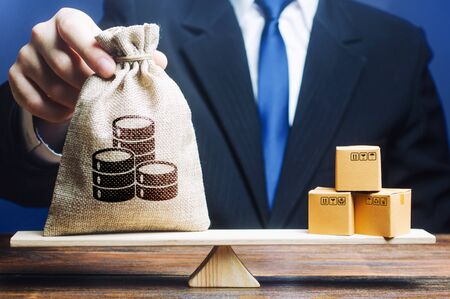 Businessman puts a money bag and bunch of boxes on scales. Trade exchange balance. Profit from manufactured goods. Retail distribution. Trade balance. Import and export, economic processes.