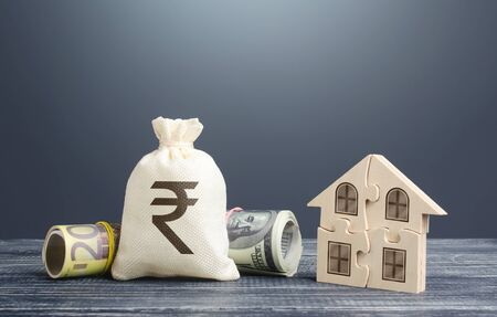 Indian rupee money bag and puzzle house. Mortgage loans building maintenance and utility services costs. Energy efficiency, savings. Social programs. Housing cooperative membership legal entity.