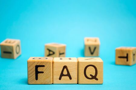 Wooden blocks with the word FAQ (frequently asked questions). Collection of frequently asked questions on any topic and answers to them. Instructions and rules on Internet sites