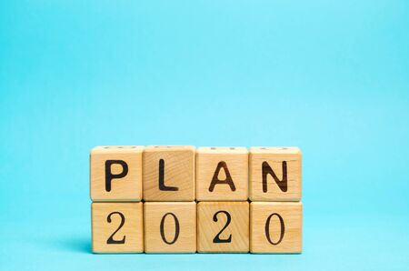 Wooden blocks with the inscription Plan 2020. The concept of achieving business goals. Execution of a business plan. Purposefulness. Planning. Strategy and management