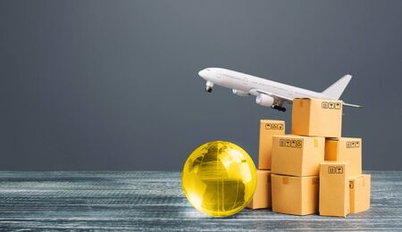 Boxes with globe and freight plane. International delivery of goods and products. Logistics, infrastructure hubs. Global business, import, export. Economic relations commerce. Cargo air transportation
