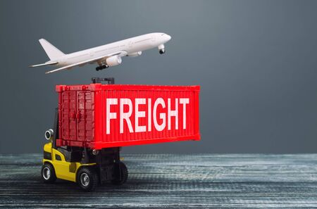 Yellow forklift carries red container and freight plane. International transportation logistics infrastructure, import export of goods products. Warehousing. Cargo transit. Air transportation