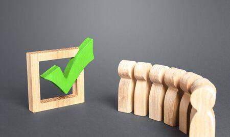 Queue line and green vote check mark. Voting in democratic election or referendum. Political campaign. Public poll. Legislative Initiative. Lobbying interests. Resolution. State legislature passes law