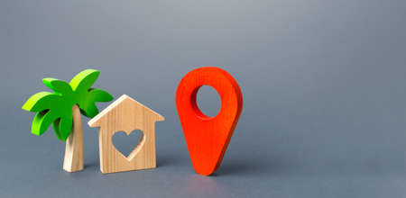 House with a heart and a red navigation pointer pin. Choosing a place for a romantic trip. A tourist guide in the post-pandemic world. New rules for traveling and staying at popular resorts.