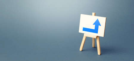 Easel with a blue right arrow. Direction to go around on the right. Advertising, indicating the location of the store object. Minimalism. Navigation, customer acquisition. Copy space