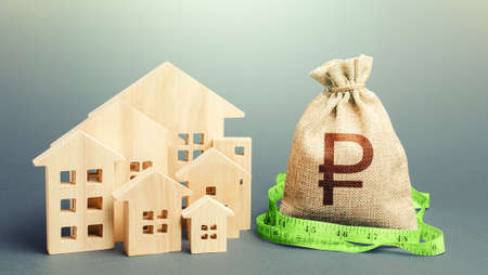 Residential houses and a russian ruble money bag. Mortgage loan. Buying, fair price. Property real estate valuation. Calculation of construction and repair expenses. City municipal budget.