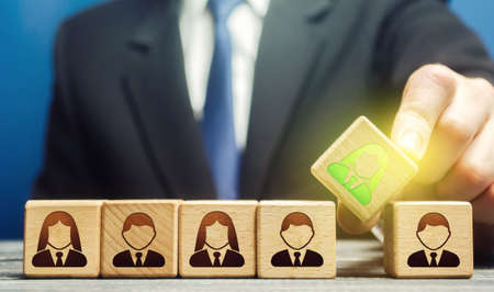A businessman appoints a leader to a team. Leadership skills. Promising talented employee. Formation effective working group. Implementation of specialists professionals in to staff. Management