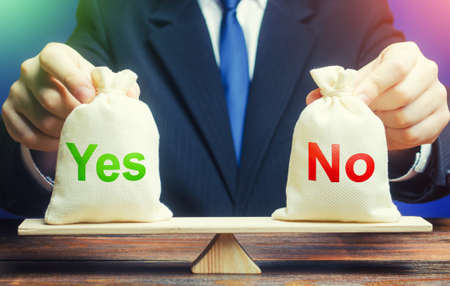 A businessman holds Yes and No bags on scales. Assessing problem and choosing right solution. Advantages and disadvantages. Choose correct answer. Find your way. Ethics and acceptability.