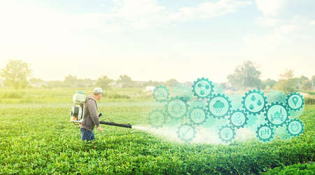 A farmer with a mist blower on potato plantation and technological innovation gears hologram. Using science and technology in agriculture to improve the efficiency and productivity of food production.