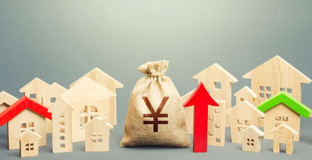 Yen Yuan money bag and a city of house figures and red up arrow. Recovery and growth in property prices, high demand. Increase in rent. Investments. Increase in revenues to municipal budget.
