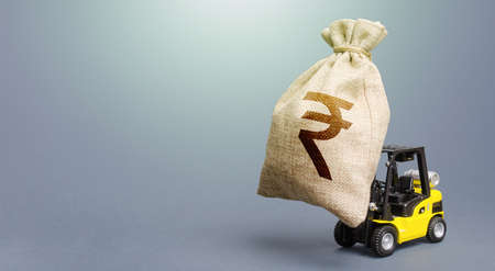Forklift carrying a indian rupee money bag. Strongest financial assistance, business support. Borrowing on capital market. Stimulating economy. Subsidies soft loans. Investments. Anti-crisis budget.