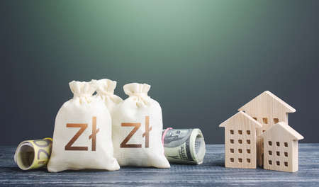 Polish zloty money bags and residential buildings figures. Financing the construction of new settlements. ortgage loan. Taxes. Municipal budget management. Investments in real estate.