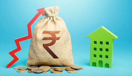 Indian rupee money bag with red up arrow and residential building. Return on investment. Recovery and growth in property cost. Increase in prices for apartments and housing. Municipal budget. 版權商用圖片