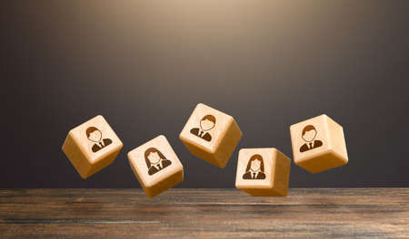 Levitating blocks with employees on a dark background. Human resources. Team creation for a new project. Leadership. Hiring and recruiting staff workers. Formation of effective working group.