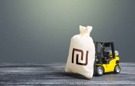 Forklift transports a israeli shekel money bag. Attraction of investments in business and economy, cheap loans, leasing. Crisis recovery measures. Borrowing on capital market. Stimulating economy.