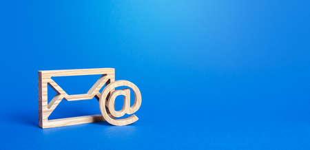 Email figure on blue background. Envelope and AT commercial sign symbol. Concept of email address. Contacts and communication. Business representations on the Internet and social media. Feedback Standard-Bild