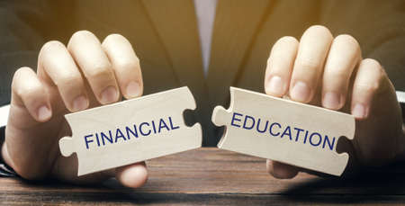 Wooden puzzles with the words Financial education. Learn investing and money management. Business and finance concept. Development and self-development. Solving financial decisions. Financial literacy