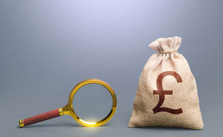 British pound sterling money bag and magnifying glass. Most favorable conditions for deposits, loans. Financial audit. Origin of capital and legality of funds. Search for financing.