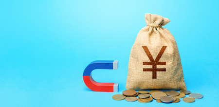 Yuan Yen money bag and magnet. Raising funds and investments in business projects and startups. Take part in tenders. Accumulation and attraction of capital. Money laundering. Tax collection. Stock Photo