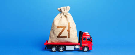 Truck is carrying a big polish zloty money bag. Anti-crisis measures of government. Great investment. Attracting large funds to the economy for subsidies, support and cheap soft loans for businesses.