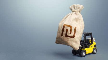 Forklift transports a israeli shekel money bag. Financial assistance, business support. Stimulating economy. Subsidies soft loans. Anti-crisis budget. Borrowing on capital market. Money transfers Stock Photo