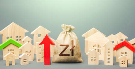 Polish zloty money bag and a city of house figures and red up arrow. Recovery and growth in property prices, high demand. Rent growth. Investments. Increase in revenues to municipal budget. Stock Photo