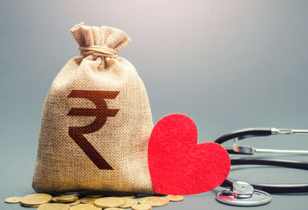 Indian rupee money bag and stethoscope. Health life insurance financing concept. Subsidies. Reforming and preparing for new challenges. Development, modernization. Funding healthcare system.