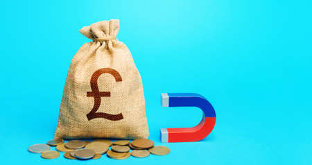 British pound sterling money bag and magnet. Raising funds and investments in business projects and startups. Accumulation and attraction of capital. Money laundering. Tax collection.