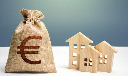 Euro money bag and residential buildings. Mortgage loan. City municipal budget. Costs of service and maintaining buildings. Property tax. Investment in real estate. Purchase of housing.
