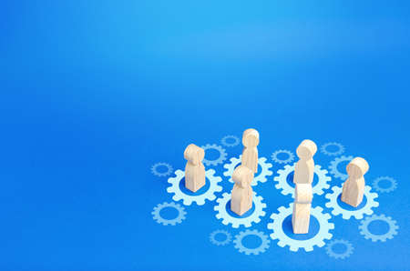 Figures of people interact with gears. Joining efforts and cooperation. Corporate machine. Communication in running company. Goal achievement. Joint development. Join team group. Teamwork