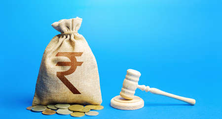 Indian rupee money bag and judge's gavel. Litigation, dispute resolution, conflict of interest settlement. Justice. Lawyer services. Awarding moral financial compensation. Protection rights.