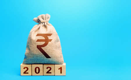 Indian rupee money bag and blocks 2021. Budget planning for next year. Revenues expenses, investment and financing. Beginning of new decade. Business plans and development prospects, trends Stockfoto