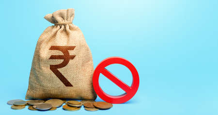 Indian rupee money bag and red prohibition sign NO. Monetary restrictions, freezing of bank accounts. Termination projects. Monitoring suspicious money flows. Confiscation of deposits.