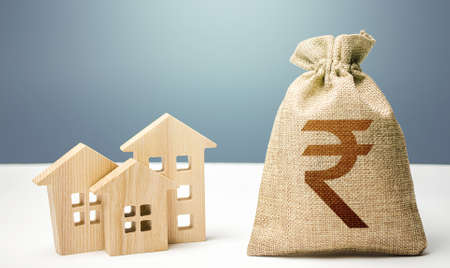 Indian rupee money bag and residential buildings. Mortgage loan. Costs of service and maintaining buildings. Property tax. Investment in real estate. Purchase of housing. City municipal budget.