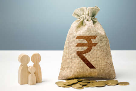 Indian rupee money bag with money and family figurines. Financial support for social institutions. Providing assistance to citizens. Investments in human capital, culture and social projects.
