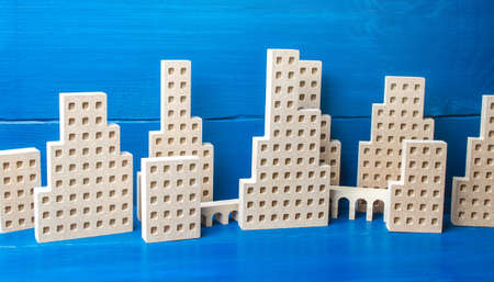 City of figures of buildings on a blue background. Concept for real estate, urban environment and transport infrastructure. City management and planning. Construction industry, growth and development.