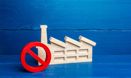 Factory industrial plant and red prohibition symbol NO. Free zone from harmful heavy industry. Environmental quotas and restrictions on environmental pollution. Bankruptcy, liquidation of enterprises. Stock Photo