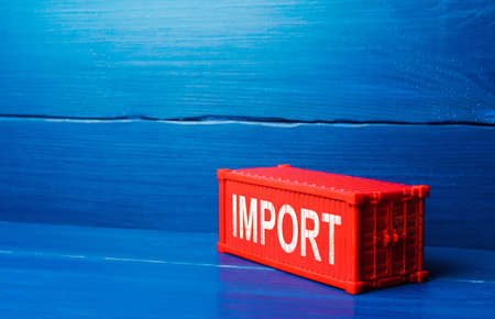 Red cargo ship container with word IMPORT. Admission of foreign goods to the national market, commercial globalization and global business. International trade, logistics. Economic processes
