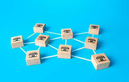 Blocks with retail shops connected by lines form network business company. Franchising concept. Business franchise. Coverage and close availability. Logistics and supply. Commercial association.