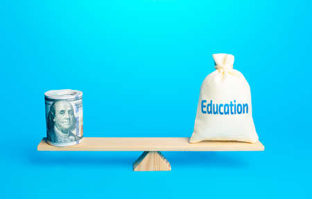 Bundle of dollars and a bag of Education on scales. Investments of budgetary funds in the educational system, a policy of improving quality of education and the release of highly qualified specialists