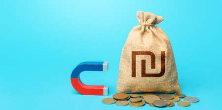 Israeli shekel money bag and red blue magnet. Tax collection. Raising funds and investments in business projects and startups. Money laundering. Accumulation and attraction of capital.