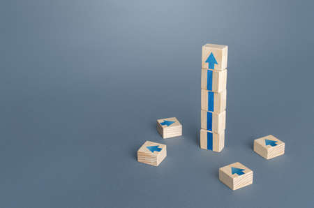 Block tower with arrows. Growth, development progress concept. Achieve success. Career promotion. Step by step. improving skills. Goal achievement. Progress and movement forward. Self improvement Foto de archivo