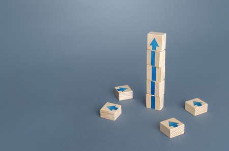 Block tower with arrows. Growth, development progress concept. Achieve success. Career promotion. Step by step. improving skills. Goal achievement. Progress and movement forward. Self improvement Stock fotó