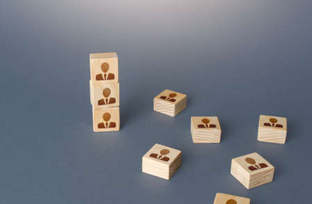 Figurine block tower with people. Hierarchical system. Company organization. Hiring, recruiting. Team building personnel leadership. Effective productive business employees group collectives. Archivio Fotografico